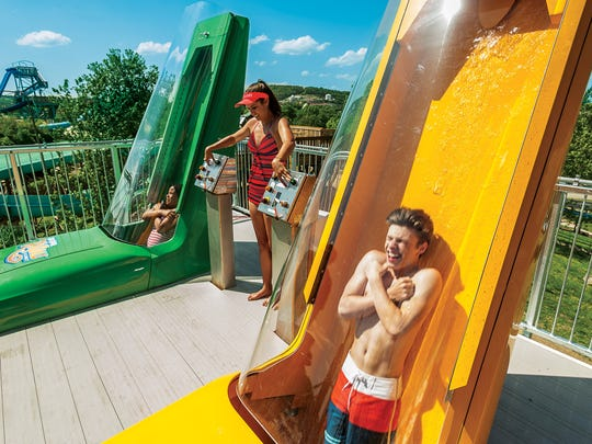 A couple of young thrill-seekers wait for a wild ride to start on the new KaPau Plummet.