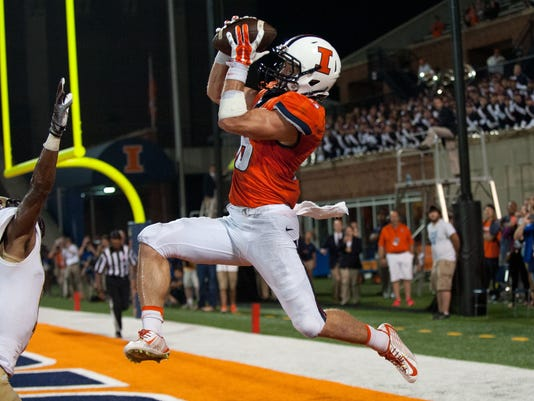 Illinois wide receiver Mike Dudek (18) makes a touchdown catch during the fourth quarter of an NCAA football game against Texas State Saturday, Sept. 20, 2014, at Memorial Stadium in Champaign, Ill. (AP Photo/Bradley Leeb)