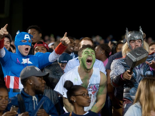 Georgia Southern University students from left, Dillon Brown, Addison Davis and Southern Alumnus Hunter Barras cheer on the football team dressed as Marvel's The Avengers during an NCAA college football game, Thursday, Oct. 30, 2014 at Paulson Stadium in Statesboro, Ga. (AP Photo/Savannah Morning News, Brittney Lohmiller) THE EXAMINER.COM OUT; SFEXAMINER.COM OUT; WASHINGTONEXAMINER.COM OUT