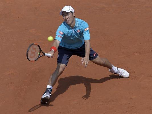 Kei Nishikori of Japan plays a return to Roberto Bautista of Spain, during the Barcelona open tennis tournament in Barcelona, Spain, Friday, April 24, 2015. (AP Photo/Manu Fernandez)
