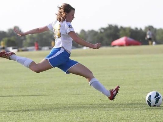 Mattilyn kicking soccer ball