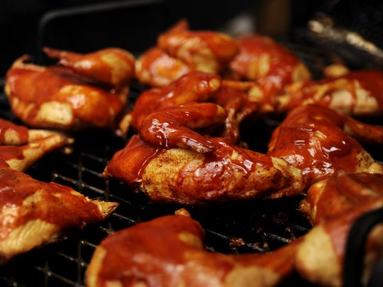 Barbecue chicken cooks on the grill Saturday morning at Johnson's Boucaniere in Lafayette.
