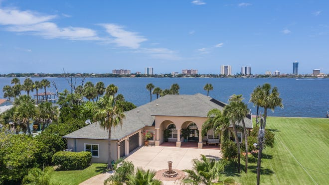 This majestic estate takes up two direct-waterfront acres on the Intracoastal Waterway, with 200 feet of deep-water frontage and two docks.