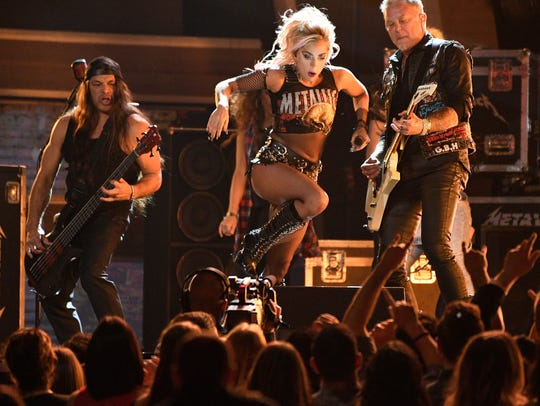 While Kirk Hammett shreds on his guitar, Gaga stage-dives