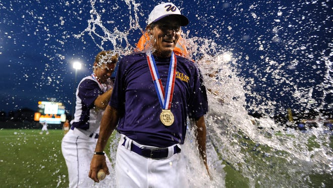 Wylie head coach Clay Martin  gets doused with water after the Bulldogs' 6-5 win over Robinson in the Class 4A state championship game on Thursday, June 8, 2017, at Disch-Falk Field in Austin.