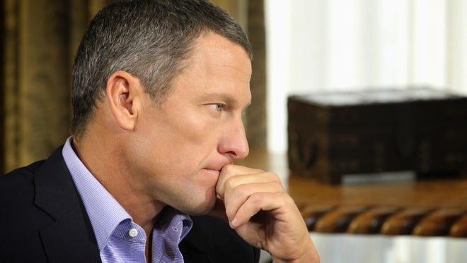 "Lance Armstrong is shown here in January as he listens to a question from Oprah Winfrey during taping for the television show on which he would confess to doping for years during his cycling career. He says in a new interview that the world he knew vanished ""almost overnight"" after his admission."