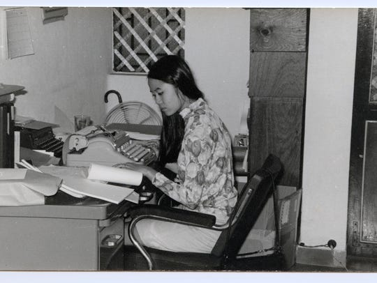 Mai Elliot working in Rand office.