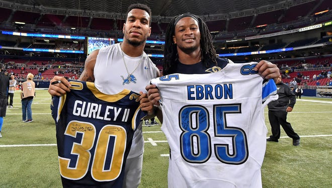 Dec 13, 2015; St. Louis, MO, USA; Detroit Lions tight end Eric Ebron (L) and St. Louis Rams running back Todd Gurley (R) swap jerseys after the game between the St. Louis Rams and the Detroit Lions at the Edward Jones Dome. The St. Louis Rams defeat the Detroit Lions 21-14.