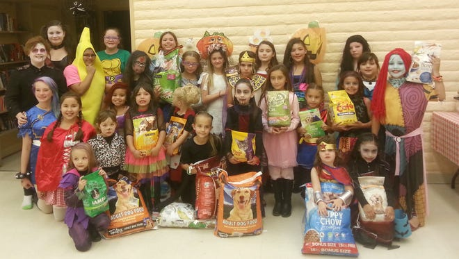 Girl Scouts of Desert Southwest from Grant County held their Annual Halloween Carnival Wednesday night. There were over 120 girls and family members that attended from eight different troops at the Tyrone Community Center. Part of the admission fee was a bag of cat/dog food for the Humane Society and we collected 156 pounds. For more information on Girl Scouts call Annette Toney at 575-538-2481.