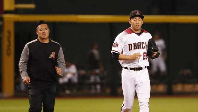 Arizona Diamondbacks relief pitcher Yoshihisa Hirano (66) enters the game during the seventh inning against the Milwaukee Brewers at Chase Field in Phoenix, Ariz. May 14, 2018.