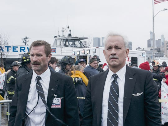 "Aaron Eckhart (left) and Tom Hanks star in ""Sully."""