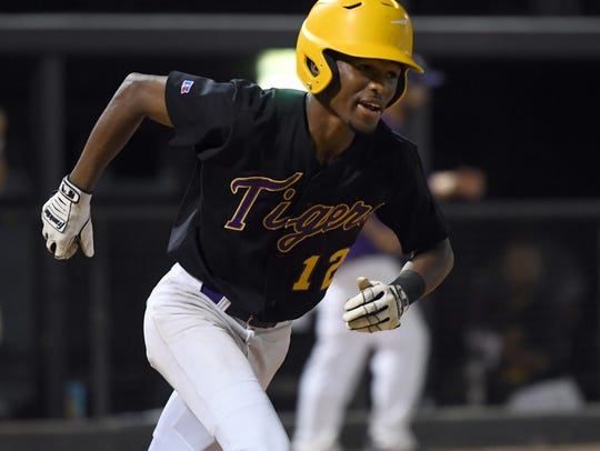 Hattiesburg High's Jay Reedy jogs to first base in