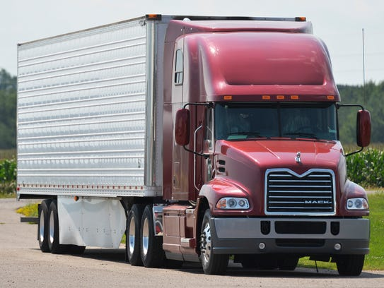 A new Mack semitractor and trailer use a variety of