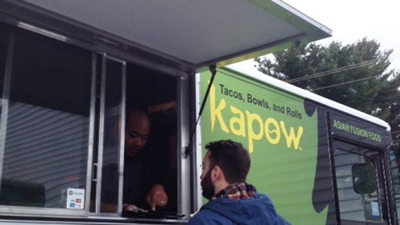 The Kapow Thai Guy Cuisine food truck features tacos, bowls and rolls. On Tuesday, it was parked in a lot off Union Street in Wilmington.