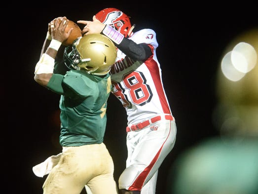 York Catholic's Jakkar Kinard (2) nearly intercepts