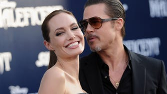 Angelina Jolie and Brad Pitt arrive May 28, 2014 at the premiere of Disney's 'Maleficent' at the El Capitan Theatre in Hollywood.
