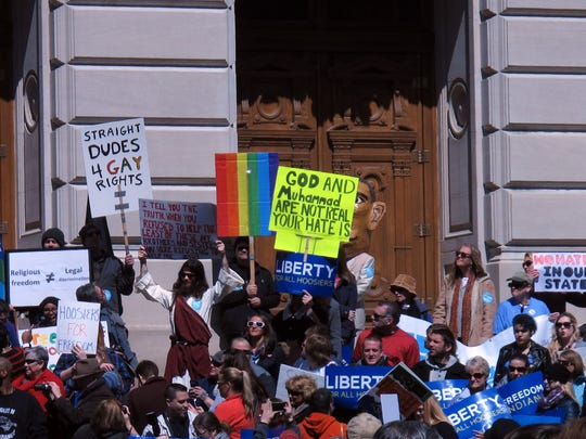Hundreds protest Indiana law that critics say allows discrimination on religious grounds