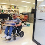 Library technician Francis Dadufalza, 48, retrieves achived newsprint articles from the library in the Richard Flores Taitano Micronesian Area Research Center at the University of Guam in Mangilao on Friday, June 10.