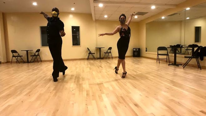 Kemar Bennett (left) co-owner of Fred Astaire Belmont and professional dancer with Essy Sosa (right) professional dancer.