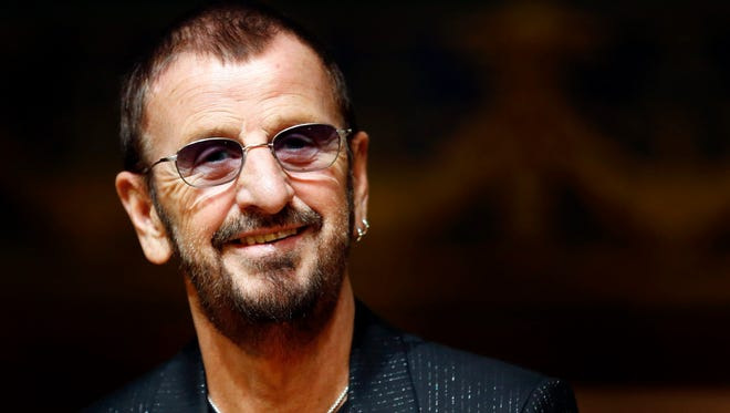 Ringo Starr attends the opening of his exhibition 'Arternativelight' at the oceanographic Museum in Monaco in 2013.