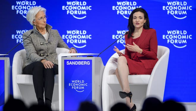International Monetary Fund Managing Director Christine Lagarde, left, and Facebook Chief Operating Officer Sheryl Sandberg on January 18, 2017.