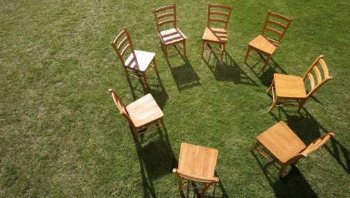 Chairs on lawn forming circle as in a support group
