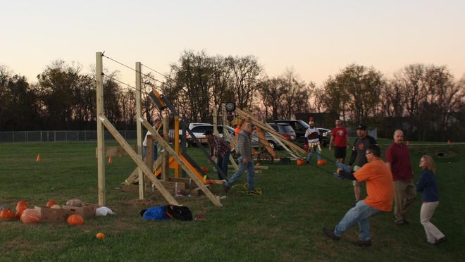 Bob Wells' pumpkin slingshot was among the machines built to launch pumpkins across the schoolyard at North Pointe Elementary Nov. 2.