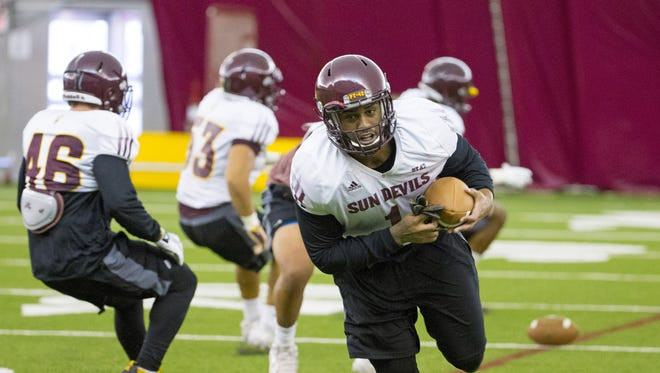 Arizona State JoJo Wicker, defensive lineman, #1, runs a drill during practice at Verde Dickey Dome in Tempe on August 6, 2016.