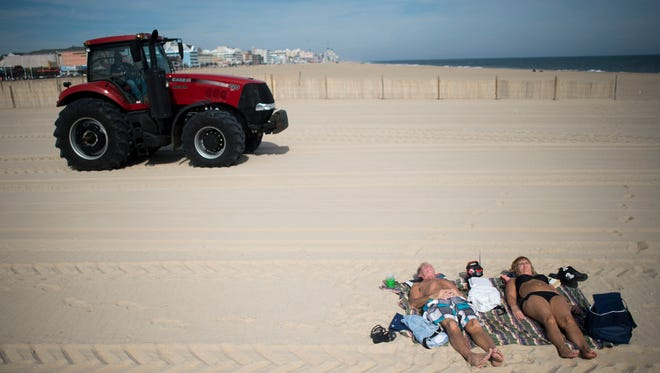 A couple in Ocean City take advantage of Tuesday's warm weather and bright sunshine Oct. 28.