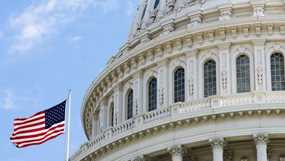 The American flag flies at the U.S. Capitol in this 2009 file photo.