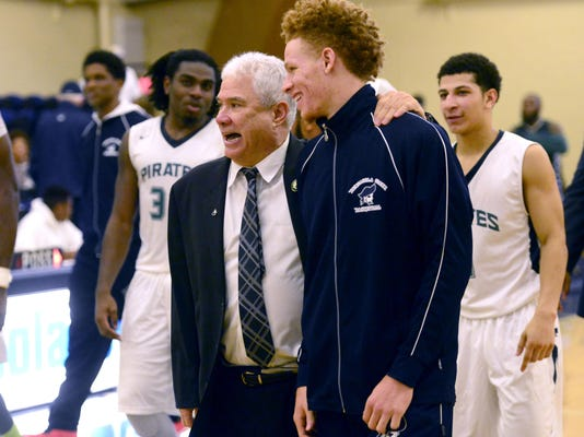 PSC basketball coach Pete Pena celebrates 100 wins