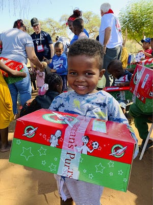 Tamra Clawson, area coordinator with Operation Christmas Child, delivers a shoebox gift to Shiloh in Namibia, Africa, in 2019. SUBMITTED PHOTO