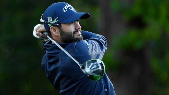 Adam Hadwin hits his tee shot on the 2nd hole during the first round of The Masters golf tournament at Augusta National Golf Club.