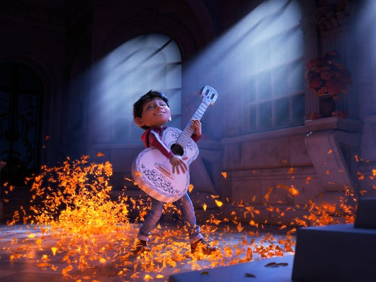 "Miguel (voiced by Anthony Gonzalez) plays an enchanted guitar in ""Coco,"" this year's Oscar winner for best animated feature. The movie is showing in free outdoor screenings in several Milwaukee-area parks this summer."