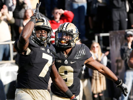 Isaac Zico of Purdue celebrates with Terry Wright after