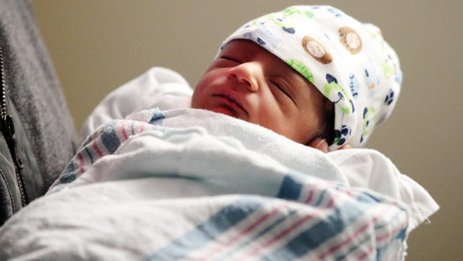 Srinivasan Ambatipati holds his son, Anirudh Naga Ambatipati, Thursday, January 1, 2015, at Women's & Children's Hospital in Lafayette, La. Anirudh was the first baby born in Lafayette in 2015, weighing 5 lbs. 8.2 oz. and measuring 19 inches long. His parents Swaroopa Podila and her husband Srinivasan Ambatipati had been trying for seven years to have a child and said they were thrilled to bring their first son into the world on New Year's Day.