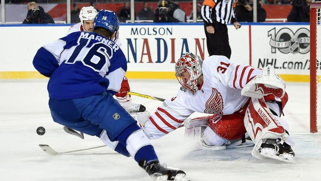 Jan 1, 2017; Toronto, Ontario, CAN;   Detroit Red Wings goalie Jared Coreau (31) pokes the puck away from Toronto Maple Leafs forward Mitch Marner (16) as Wings defenceman Jonathan Ericsson (52) follows the rebound during the Centennial Classic ice hockey game at BMO Field. Mandatory Credit: Dan Hamilton-USA TODAY Sports