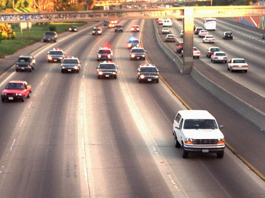 A white Ford Bronco, driven by Al Cowlings and carrying O.J. Simpson, is trailed by police cars as it travels on a southern California freeway on June 17, 1994, in Los Angeles.