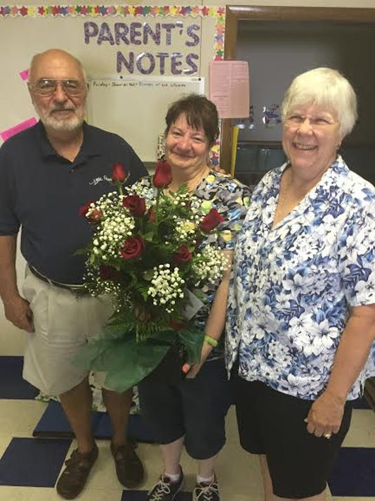 Teresa Harmon, center, recently celebrated 20 years of employment at Little People Day School, 71 Fairview Drive, Hanover. Shown with Teresa are Dennis and Barbara Bidwa, owners.