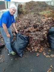 Steve Sirianni volunteers his time to haul leaves from United Way's Make A Difference Day.