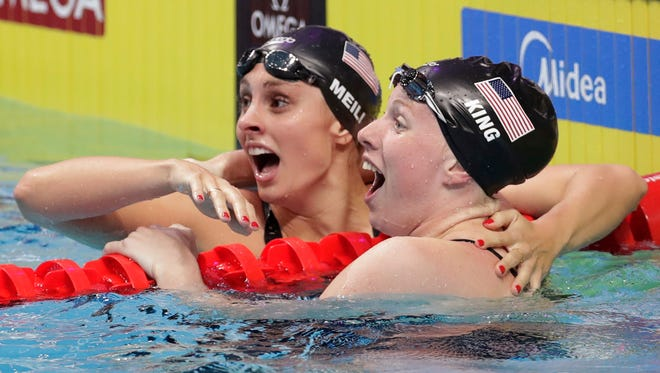 U.S. swimmer Lilly King, right, is congratulated by teammate Katie Meili as she celebrates after setting a new world record in the women's 100-meter breaststroke final during the swimming competitions of the World Aquatics Championships in Budapest, Hungary, on July 25. King won gold and Meili took silver.