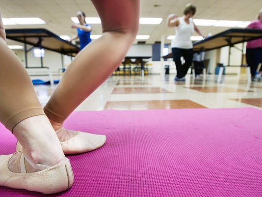 If you're bored of your workout, try something new, such as attending a new class or jogging a new route. In this photo, instructor Lindsay Schultz leads her Ballet Body Sculpt class in the basement of Zion Lutheran Church in Glen Rock. (Daily Record/Sunday News -- Paul Kuehnel)