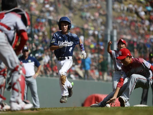 Red Land's Braden Kolmansberger races home during the 1st inning of the Little League World Series Championship in Williamsport, Pa., Sunday, August 30, 2015. Kolmansberger was one of ten runs scored by Red Land in the 1st inning. Japan beat Red Land 18-11.