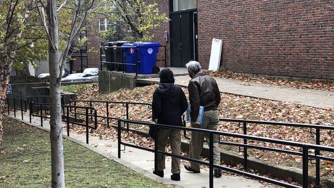 """Joel Caffey and Mojave Nedjadi; Nedjadi shows off her """"I Voted"""" sticker."""