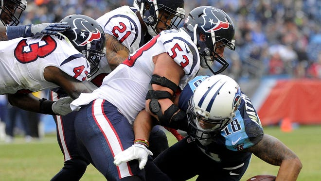 Tennessee Titans wide receiver Rishard Matthews (18) is stopped by Houston Texans inside linebacker Max Bullough (53) just before the goal line in the second quarter  during the NFL game at Nissan Stadium.