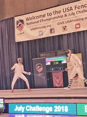Rebekah Bucur, left, was the runner-up at the women's Epee Division II final at the USA Fencing National Championships in St. Louis.
