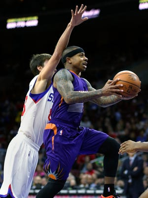 Phoenix Suns guard Isaiah Thomas drives to the basket as Philadelphia 76ers guard Alexey Shved defends in the first half on Friday, Nov. 21, 2014, in Philadelphia.