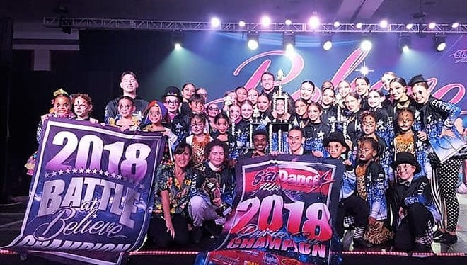 True Crew celebrates its wins at the at the Believe National Talent Competition in Fort Lauderdale.