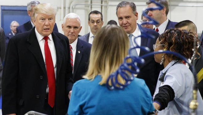President-elect Donald Trump and Vice President-elect Mike Pence talk to workers Dec. 1 during a visit to the Carrier furnace plant on Indianapolis' west side.