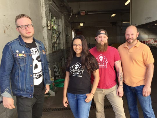 Wild Bones Brewing owners Steven McConnell, Alaine Anderson, Anthony Necco, and Scott Anderson stand at the entrance to their brewery, which they hope to open in spring of 2018.